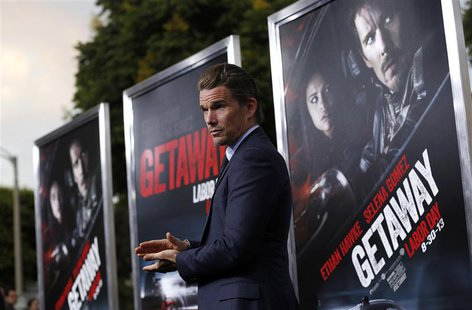 "Cast member Ethan Hawke poses at the premiere of ""Getaway"" in Los Angeles, California August 26, 2013. REUTERS/Mario Anzuoni"