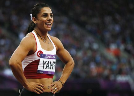 Turkey's Nevin Yanit reacts after her women's 100m hurdles semi-final during the London 2012 Olympic Games at the Olympic Stadium August 7,