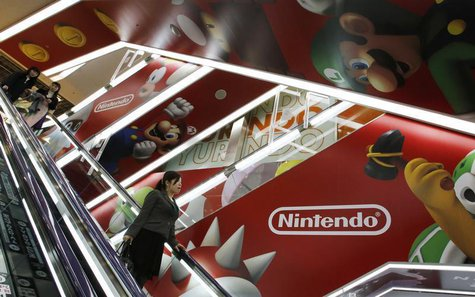 People ride an escalator past Nintendo Co advertisements at an electronics retail store in Tokyo April 23, 2013. REUTERS/Toru Hanai