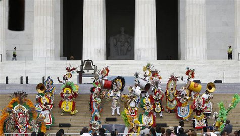 "Members of Junkanoo perform during a ceremony marking the 50th anniversary of Martin Luther King's ""I have a dream"" speech on the steps of t"