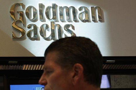 A trader works inside the Goldman Sachs stall on the floor at the New York Stock Exchange July 16, 2013. REUTERS/Brendan McDermid