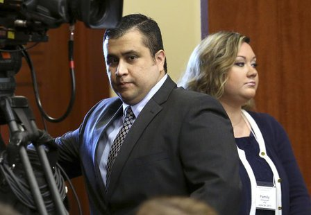 George Zimmerman with his wife Shellie (R), arrives in Seminole circuit court on the opening day of his trial, in Sanford, Florida, June 24,