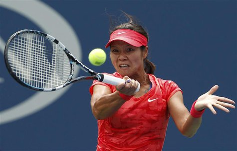 Li Na of China hits a return to Sofia Arvidsson of Sweden at the U.S. Open tennis championships in New York August 28, 2013. REUTERS/Adam Hu