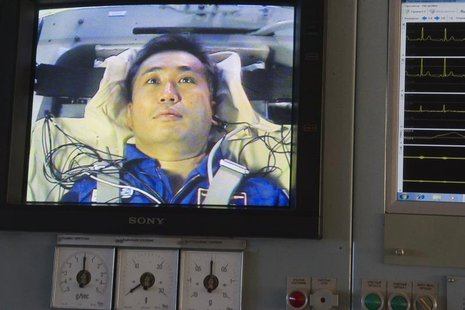 Japanese astronaut Koichi Wakata is seen on a monitor during a training exercise in a cetrifuge at the Star City space centre outside Moscow