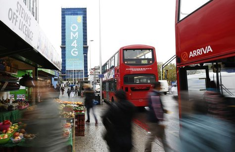 A billboard advertises 4G mobile telecom services of market leader EE, owned by France Telecom and Deutsche Telekom, at Elephant & Castle in