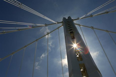 The sun shines through the Bay Bridge's Self-Anchored Suspension tower in San Francisco, California August 26, 2013. REUTERS/Robert Galbrait