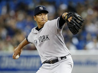 New York Yankees pitcher Hiroki Kuroda pitches against the Toronto Blue Jays during the first inning of their MLB American League baseball g