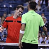 Andy Murray of Britain shakes hands at the net with Michael Llodra of France after winning his opening match at the U.S. Open tennis champio
