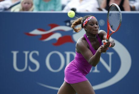 Sloane Stephens of the U.S. hits a return to Mandy Minella of Luxembourg at the U.S. Open tennis championships in New York, August 26, 2013.