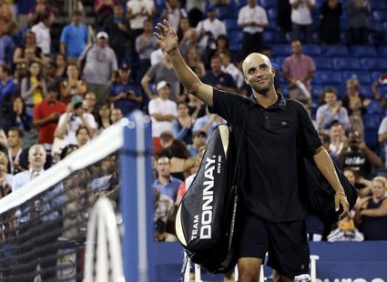 James Blake of the U.S. waves to the crowd after losing to Ivo Karlovic of Croatia at the U.S. Open tennis championships in New York August