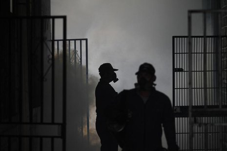 Health workers fumigate a school in Tegucigalpa August 9, 2013. REUTERS/Jorge Cabrera