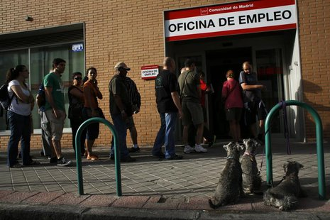 Dogs wait for their owner as people enter a government-run employment office in Madrid August 2, 2013. REUTERS/Susana Vera