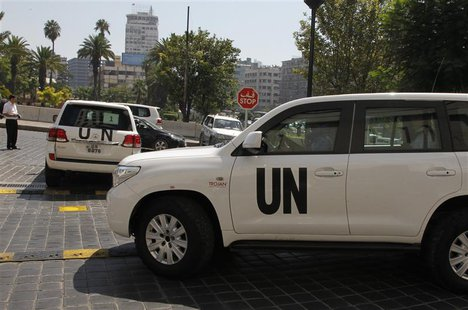 U.N. vehicles carrying a team of United Nations chemical weapons experts leave the hotel where they are staying at in Damascus August 29, 20