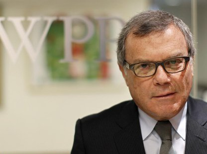 Martin Sorrell, chief executive officer of WPP group, poses outside the company's offices as part of the Reuters Global Media Summit in New