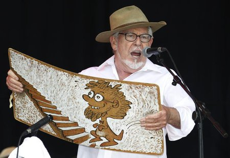 Australian singer Rolf Harris performs with his wobbleboard at the Glastonbury Festival 2010 in south west England, June 25, 2010 file photo