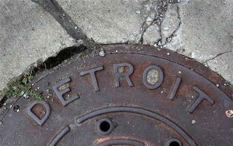 'Detroit' is seen on the top of an iron man-hole cover on a street in Detroit, Michigan July 27, 2013. REUTERS/ Rebecca Cook