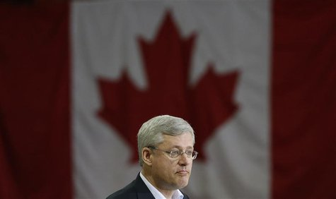 Canadian Prime Minister Stephen Harper takes part in a news conference in Hay River, Northwest Territories August 20, 2013. REUTERS/Chris Wa