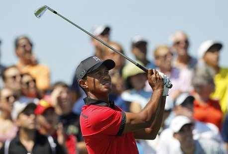 Tiger Woods of the U.S. hits his tee shot on the second hole during final round play in the Barclays' PGA golf tournament in Jersey City, Ne