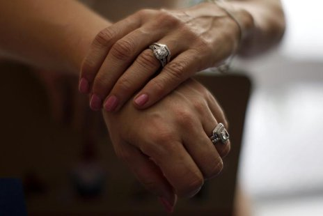 Sallee Taylor, 41, (L) and her wife Andrea Taylor, 41, hold hands after getting married in West Hollywood, California, July 1, 2013. REUTERS