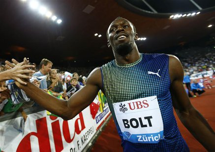 Usain Bolt of Jamaica celebrates after winning the men's 100 metres at the Weltklasse Diamond League athletics meeting in Zurich August 29,