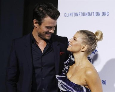 "Actor Josh Duhamel (L) and his wife singer Fergie arrives at The Clinton Foundation Gala in celebration of the organization's ""Decade of Dif"