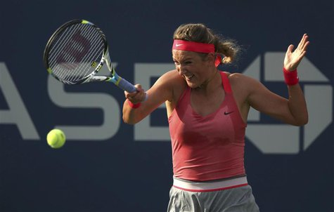 Victoria Azarenka of Belarus hits a return to Aleksandra Wozniak of Canada at the U.S. Open tennis championships in New York August 29, 2013