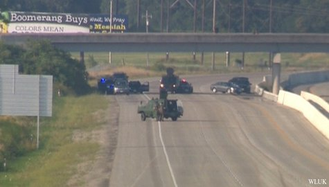 Authorities work at the scene of a standoff with armed robbery suspects on Hwy. 41 in Oshkosh, Aug. 28, 2013. (Photo by: FOX 11).