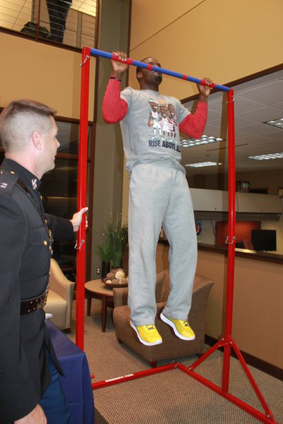 James Jones displays his pull-up power for The Marines