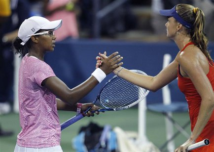 Victoria Duval of the U.S. (L) shakes hands after losing to Daniela Hantuchova of Slovakia at the U.S. Open tennis championships in New York