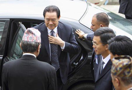 China's Politburo Standing Committee Member Zhou Yongkang (L) arrives for a meeting with Nepal's caretaker Prime Minister Jhala Nath Khanal