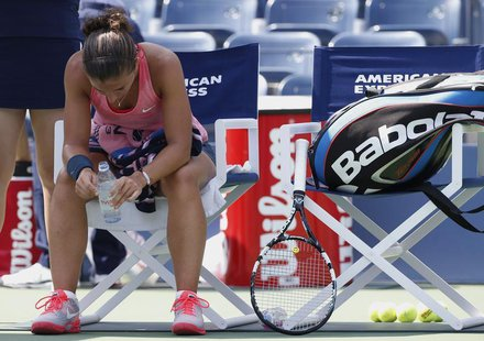 Sara Errani of Italy sits during a break in play against compatriot Flavia Pennetta at the U.S. Open tennis championships in New York August
