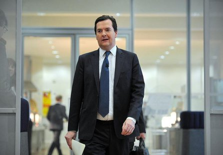 Britain's Chancellor of the Exchequer George Osborne arrives to speak at a news conference at the conclusion of the International Monetary F