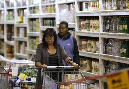 A shopper pushes a trolley of groceries at the Makro branch of South African retailer Massmart in Johannesburg May 31, 2011. REUTERS/Siphiwe