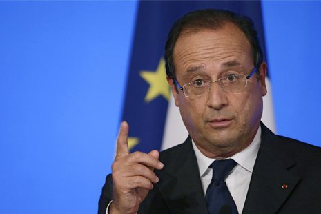 France's President Francois Hollande reacts as he delivers a speech during the annual Conference of Ambassadors at the Elysee Palace in Pari