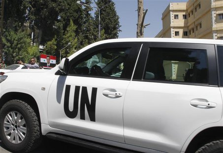 A U.N. vehicle carrying United Nations chemical weapons experts is seen at Yousef al-Azma military hospital in Damascus August 30, 2013. REU