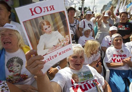 A supporter of jailed former Ukrainian Prime Minister and opposition leader Yulia Tymoshenko holds a portrait of her during a rally in centr