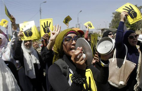 Members of the Muslim Brotherhood and supporters of ousted Egyptian President Mohamed Mursi shout slogans against the military and the inter