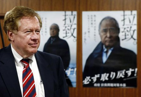 Robert King, U.S. special envoy for North Korean human rights issues, stands in front of campaign posters of Japan's abduction issue during