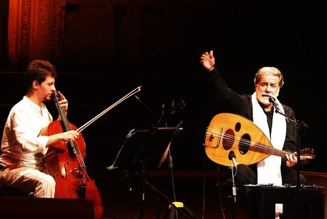 Lebanese composer and singer Marcel Khalife performs with cello player Sari Khalife during the Baalbek festival, which was held in La Magnan