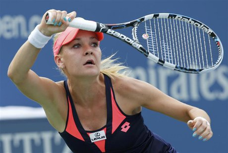 Agnieszka Radwanska of Poland hits a return to Anastasia Pavlyuchenkova of Russia at the U.S. Open tennis championships in New York August 3