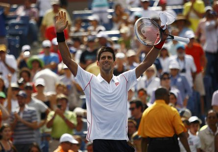 Novak Djokovic of Serbia waves after defeating Benjamin Becker of Germany at the U.S. Open tennis championships in New York August 30, 2013.