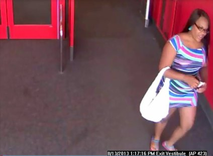 Suspect sought in counterfeit money incidents at Bellevue Target store on Aug. 13, 2013. (Photo by: Brown County Sheriff's Department).