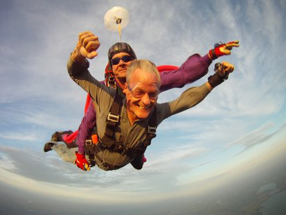 Governor Dennis Daugaard parachuting over Madison, S.D. (SD.gov)