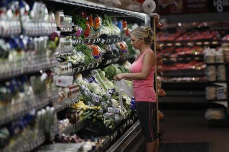 A customer shops at a Walmart Supercenter in Rogers, Arkansas June 6, 2013. Credit: Reuters/Rick Wilking