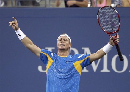 Lleyton Hewitt of Australia celebrates defeating Juan Martin Del Potro of Argentina in the 5th set at the U.S. Open tennis championships in