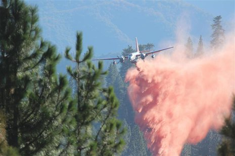 A tanker drops retardant on the Rim Fire in this undated United States Forest Service handout photo near Yosemite National Park, California,