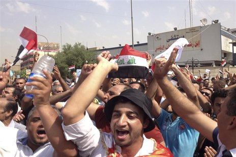 Protesters demand that the pensions of parliamentarians be cancelled during a demonstration in Baghdad August 31, 2013. Thousands are rallyi