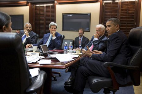 U.S. President Barack Obama (R) meets with his national security staff to discuss the situation in Syria in the Situation Room of the White