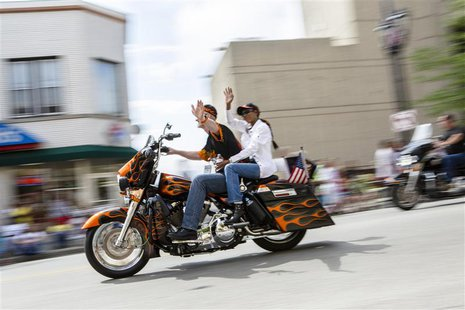 Harley riders wave during the Harley Davidson 110th Anniversary Celebration parade in Wisconsin Avenue, Milwaukee August 31, 2013. REUTERS/S