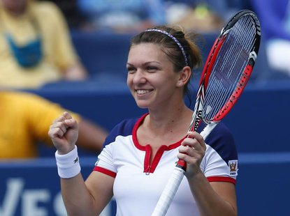 Simona Halep of Romania reacts after defeating Maria Kirilenko of Russia at the U.S. Open tennis championships in New York August 31, 2013.